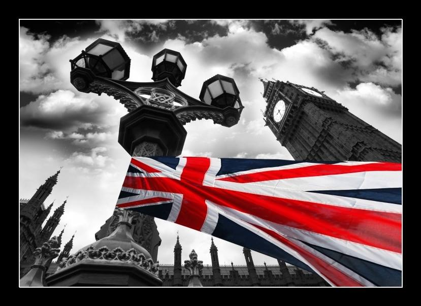 Big Ben with colorful flag of England, London, UK