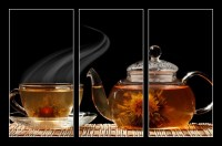 Glass teapot and a cup of green tea on a black background (1/2)