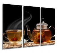 Glass teapot and a cup of green tea on a black background (2/2)